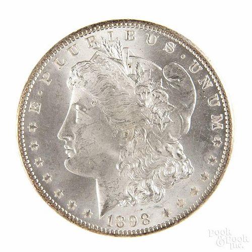 Silver Morgan dollar coin, 1898 O, MS-64 to MS-65.