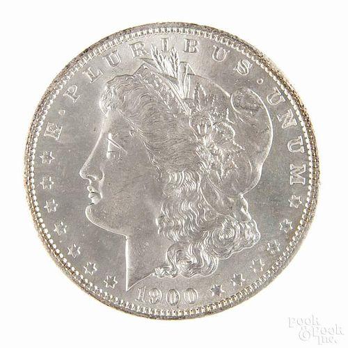 Silver Morgan dollar coin, 1900 O, MS-63 to MS-64.