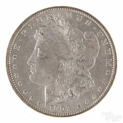 Silver Morgan dollar coin, 1903 O, MS-64 to MS-65.