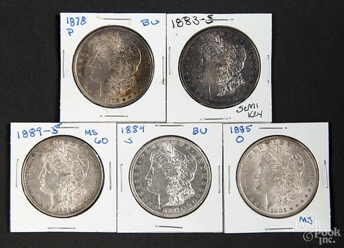 Five silver Morgan dollar coins, to include an 1878, an 1883 S, an 1884 S, an 1885 O, and an 1889 S,