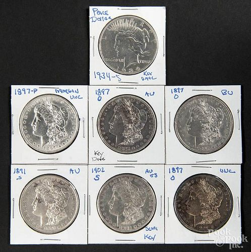 Six silver Morgan dollars, to include an 1891 S, an 1897, three 1897 O, and a 1902 S, together with