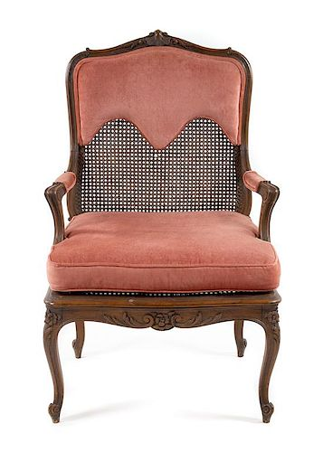 * A Louis XV Style Caned Fauteuil Height 41 inches.