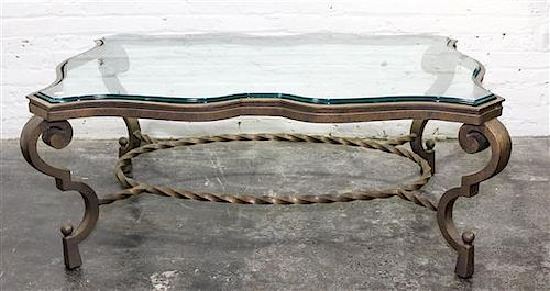 * A Wrought Iron and Glass Low Table Height 19 5/8 x width 50 1/2 x depth 22 3/4 inches.
