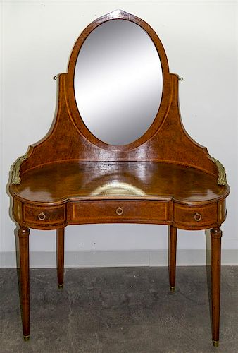 A Burlwood Mother-of-Pearl Inlaid and Gilt Metal Mounted Dressing Table Height 64 1/4 x width 44 x depth 20 inches.