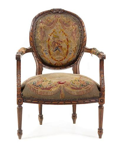 A Louis XVI Style Fauteuil Height 35 inches.