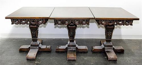 A Renaissance Revival Triple Pedestal Dining Table Height 29 1/2 inches.