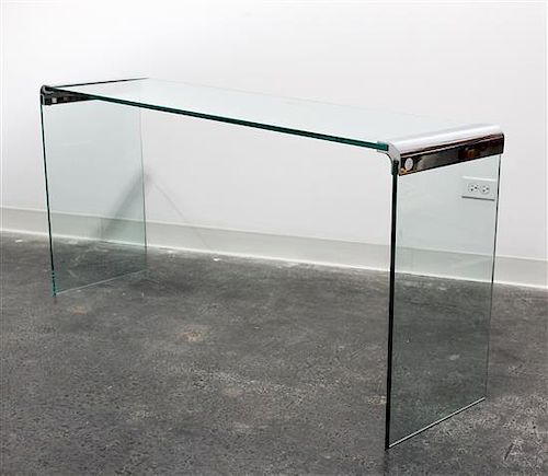 A Chrome and Glass Cocktail Table Length of top 57 inches overall.