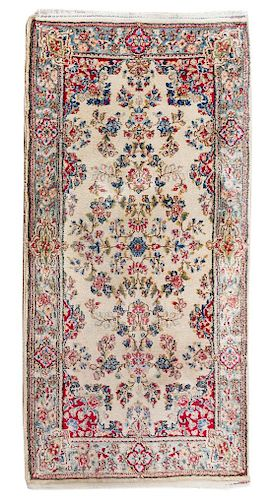 * A Kirman Wool Rug 4 feet 10 inches x 2 feet 6 inches.