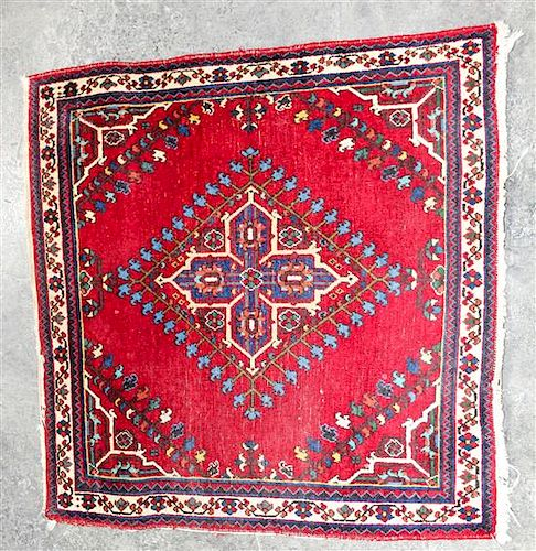 A Persian Mat 2 feet 9 inches x 2 feet 8 inches.
