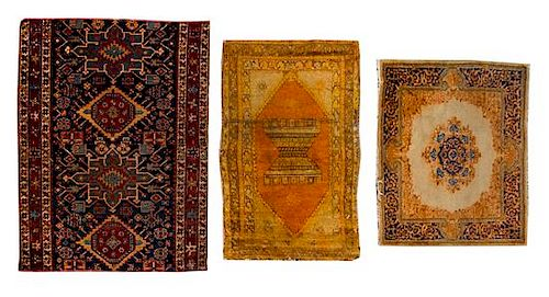 * Three Persian Wool Rugs and Rug Fragments Largest 4 feet 2 inches x 3 feet 9 inches.