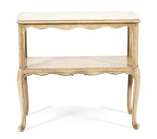 A Louis XV Style Painted Two-Tier Occasional Table Height 23 x width 25 x depth 13 inches.