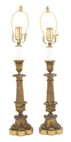 A Pair of Louis XV Style Patinated Gilt Bronze Candlesticks Height of candlestick 13 7/8 inches.