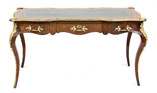 A Louis XV Style Gilt Bronze Mounted Inlaid Walnut Bureau Plat Height 29 x width 53 1/2 x depth 28 1/2 inches.