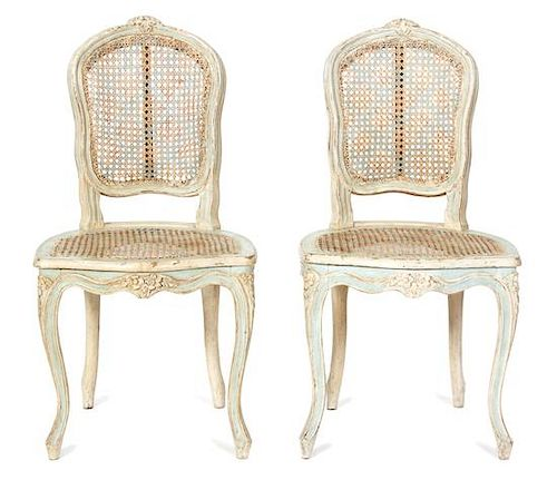 A Pair of Louis XV Cane Back Painted Side Chairs Height 35 1/2 inches.