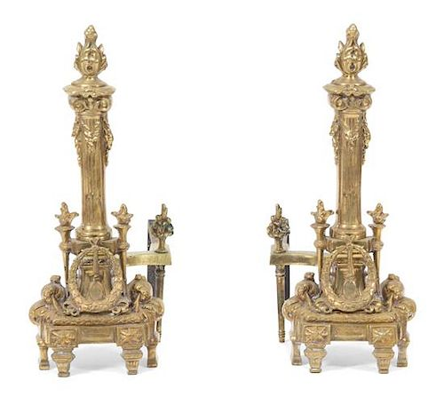 A Pair of Louis XVI Style Gilt Bronze Chenets Height 19 3/4 inches.