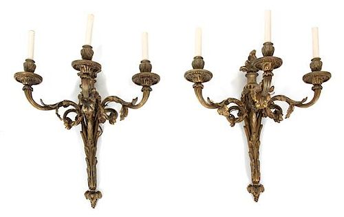 A Pair of Louis XVI Style Gilt Bronze Three-Light Wall Sconces Height 20 x length 19 inches.