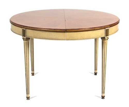 A Louis XVI Style Painted Oval Dining Table Height 29 1/2 x diameter 44 inches. Each leaf 20 inches.