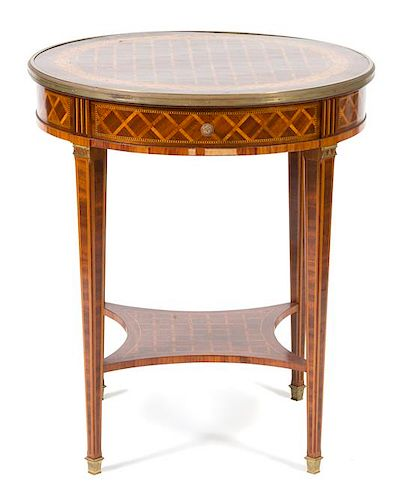 A Louis XVI Style Parquetry Inlaid Gilt Bronze Mounted Gueridon Height 29 1/2 x diameter 25 1/2 inches.