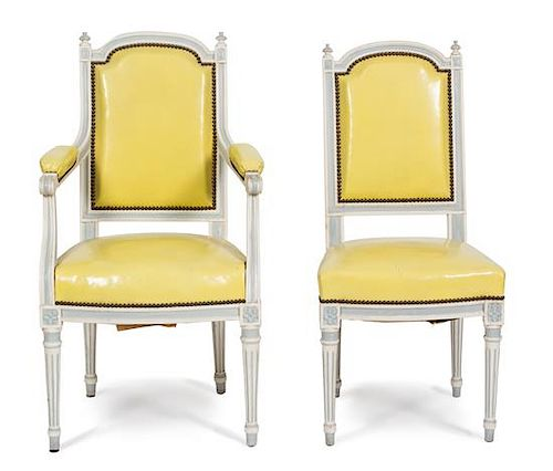 A Set of Eight Louis XVI Style Painted Dining Chairs Height of armchair 39 inches.