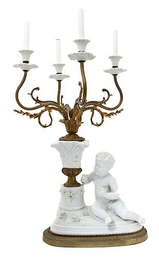 A Continental Bisque Mounted Gilt Bronze Four-Light Candelabrum Height to bulb 29 x width 14 x depth 14 inches.