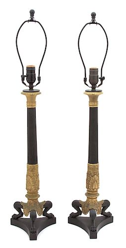 A Pair of French Empire Style Patinated and Gilt Bronze Columnar Table Lamps Height overall 31 inches.