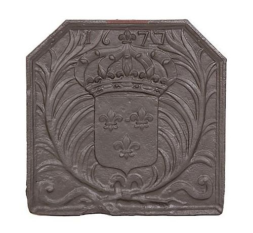 A Patinated Cast Iron Fire Back with Coat of Arms Height 28 x width 28 inches.