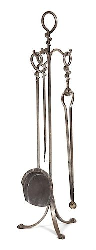 A Steel Fire Tool Set on Stand Height of stand 36 1/4 inches.