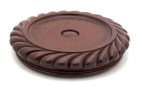 An English Carved Mahogany Circular Base Diameter 9 1/2 inches.