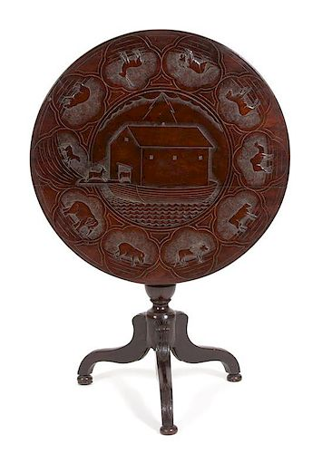 A British Colonial Carved Mahogany Tripod Table Height 28 1/2 x diameter 29 inches.