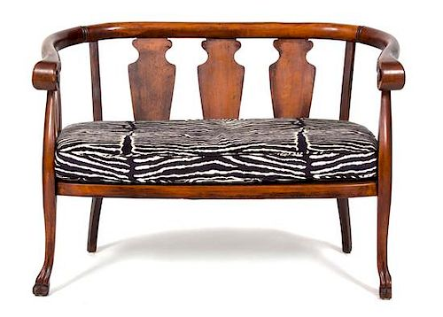 A British Colonial Mahogany Loveseat and Barrel-Back Rocking Chair Height of loveseat 32 x width 45 x depth 23 inches.