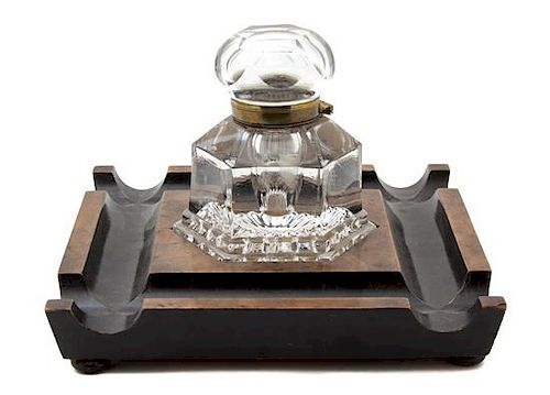 An English Walnut, Parcel Ebonized and Cut Glass Inkwell Height 6 3/4 x 10 1/4 inches square.