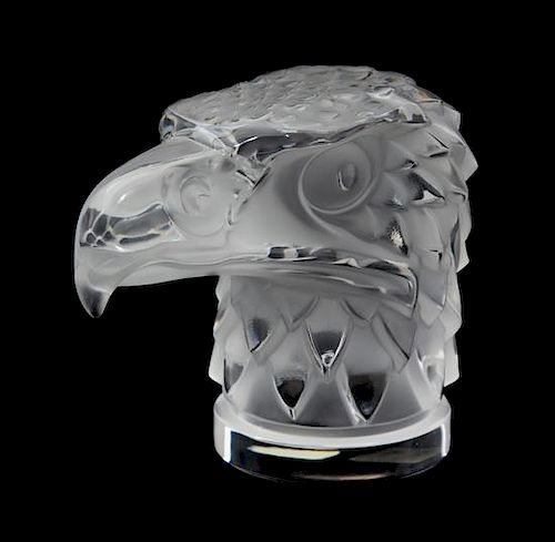 A Lalique Molded and Frosted Glass Tete D'Aigle Height 4 1/2 inches.