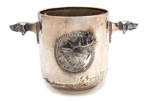 A Silver Plate Hand Hammered Ice Bucket with Hound's Head Handles Height 8 1/4 inches.