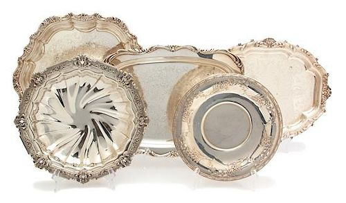 A Collection of Five Silver Plate Serving Pieces Length of largest 16 inches.