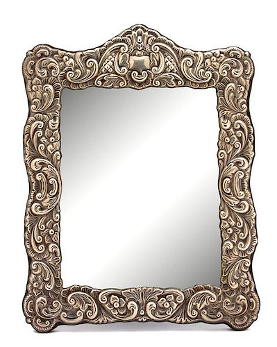 An English Silver Repousse Mounted Easel-Back Mirror, R. Carr Ltd., Sheffield, 1989,