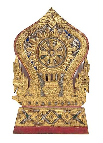 An Indian Carved and Gilt Polychrome Temple Fragment Height 19 inches.