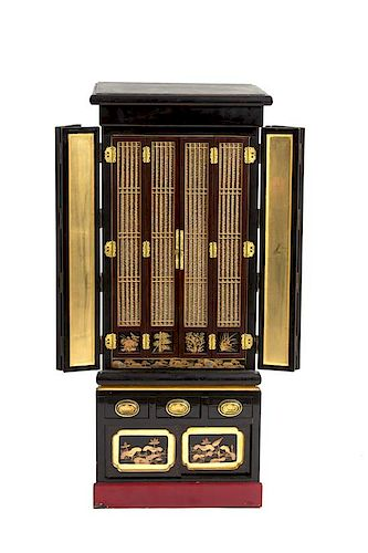 A Japanese Black Lacquered Household Shrine Height 48 1/2 x width 19 x depth 6 inches.