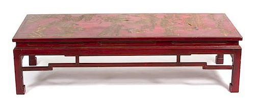 A Chinese Red and Gold Lacquered Low Table Height 15 1/2 x width 59 x depth 23 1/2 inches