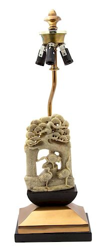 A Chinese Carved Soapstone Sculpture Mounted as a Lamp Height of soapstone 6 1/2 inches, lamp 19 inches.