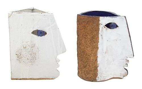 A Pair of Glazed and Painted Ceramic Face-Form Candleholder Height of largest 11 inches.