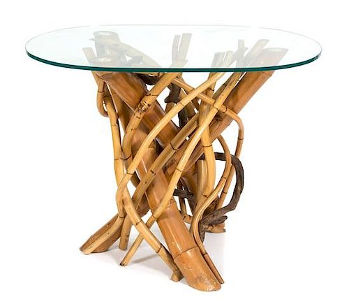 A Twisted Bamboo Glass Top Table Height 30 x width 38 x depth 26 3/4 inches.