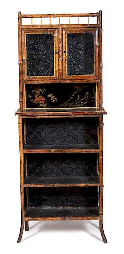 A Victorian Style Burnt Bamboo and Lacquer Display Cabinet Height 73 x width 29 x depth 12 1/2 inches.