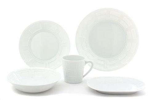 A Partial Set of Bernardaud Limoges Porcelain Diameter of dinner plate 10 1/4 inches.