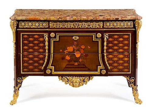 A Louis XVI Style Gilt Bronze Mounted Marquetry Commode Height 35 x width 52 7/8 x depth 19 7/8 inches.