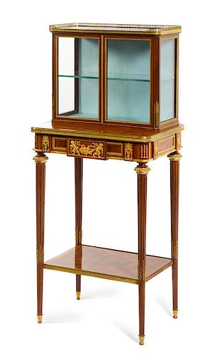 A Louis XVI Style Gilt Bronze Mounted Parquetry Vitrine Cabinet Height 46 3/4 x width 20 3/4 x depth 15 inches.