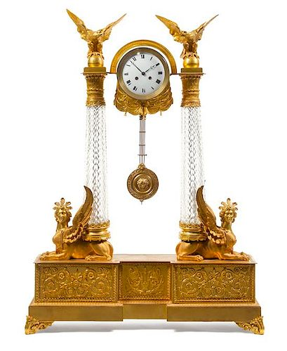 An Empire Style Gilt Bronze and Cut Glass Clock Height 44 1/4 x width 31 3/4 x depth 7 inches.