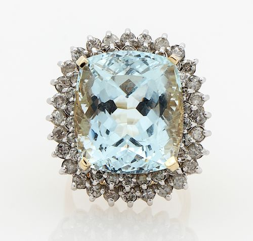 A 14kt. yellow gold Aquamarine and Diamond double halo cocktail ring