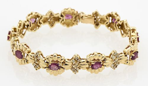 A 14kt yellow gold Ruby and Diamond link bracelet