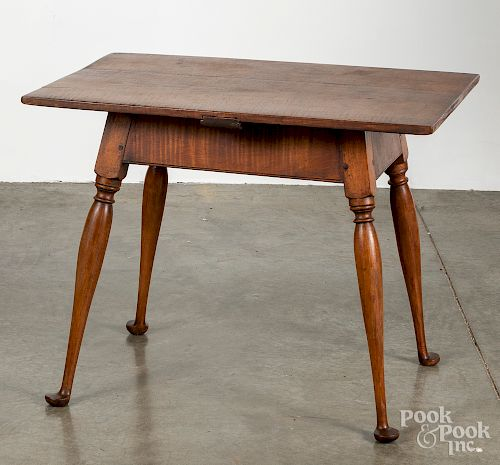 Bench made tiger maple tavern table, 20th c.