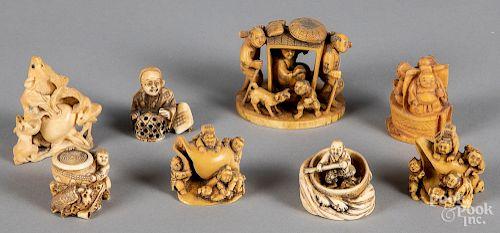 Eight Japanese Meiji period carved ivory netsuke.